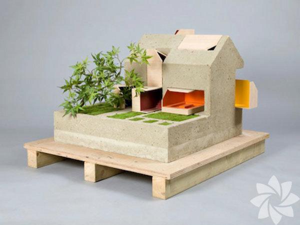 """""""Inside Out"""" ismi verilen bebek evi, önündeki bonsai ağacı ve baharat bahçesi ile çocuklarda dışarda oynama isteği yaratmayı amaçlıyor."""