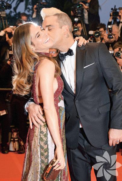 Cannes Film Festivali'ne önceki gün Robbie Williams ve Türk eşi Ayda Field'ın kırmızı halı romantizmi damga vurdu.