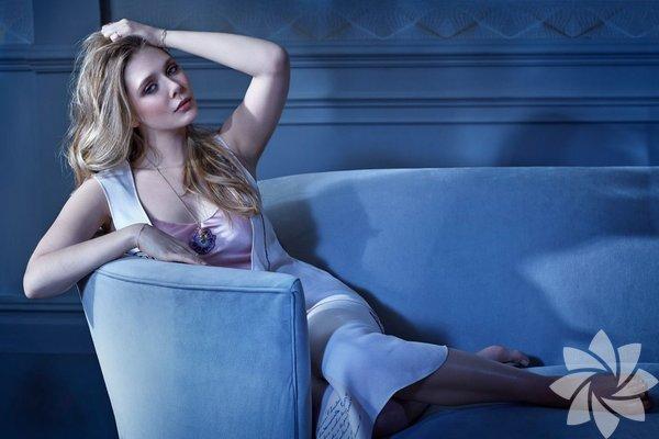 """Elizabeth Olsen  5 yaşındayken oynadığı bir TV filmini saymazsak sinemaya başrolle başlayan nadir oyunculardan biri. 2011 yapımı """"Sessiz Ev""""deki dikkat çekici performansının ardından başrol serisini sürdürdü. """"Paranoya"""", """"Very Good Girls"""" ve """"Oldboy"""" filmlerinde oyunculuğunu kanıtladıktan sonra sıra süper prodüksiyonlara geldi. """"Godzilla"""" bir yana Olsen özellikle """"Kaptan Amerika: Kış Askeri"""" ve """"Yenilmezler: Ultron Çağı""""nda canlandırdığı Wanda Maximoff rolüyle bir Hollywood yıldızı olma yolunda emin adımlar atıyor. Doğum tarihi: 16 Şubat 1989"""
